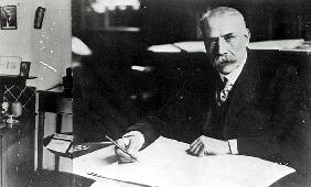 Sir Edward Elgar (1857-1934) at work on one of his orchestral scores