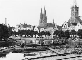 Selling wood on the River Trave, Lubeck, c.1910 (b/w photo)