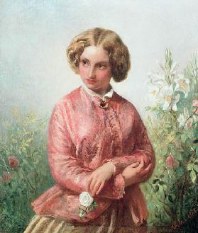 Portrait of a young girl with a rose