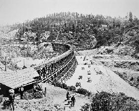 Chinese labourers working on a trestle bridge on the western slope of the Sierra Nevada mountains, 1 19th
