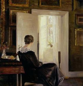 A woman seated near a door 19th