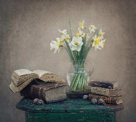 Still life with daffodils, old books and snails