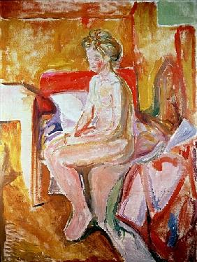Girl seated on the edge of her bed