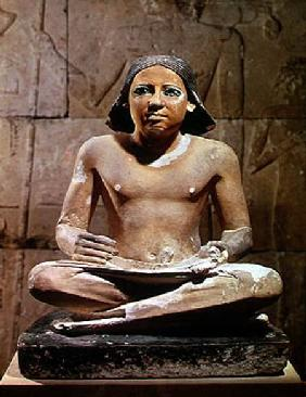 Scribe seated cross-legged holding a papyrus scroll, from Saqqara, Old Kingdom c.2475 BC Old Kingdo