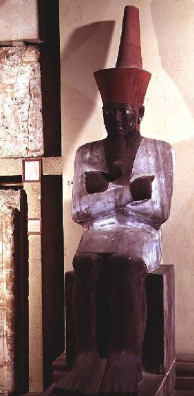 Statue of Mentuhotep II, enthroned and wearing the red crown of Lower Egypt, taken from the Mortuary
