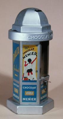 Toy Moneybox advertising the chocolate 'Menier' delivering chocolate to the children, c.1930 (tin) 1826