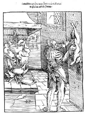 View of a sixteenth century kitchen with cook gutting a rabbit