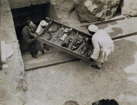 A tray of chariot parts being removed from the Tomb of Tutankhamun, Valley of the Kings, 1922 (gelat