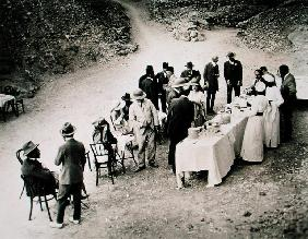 Distinguished visitors taking refreshments near the Tomb of Tutankhamun at the opening of the inner