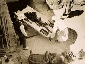 Funeral bouquet being removed from the Tomb of Tutankhamun, Valley of the Kings, 1922 (gelatin silve