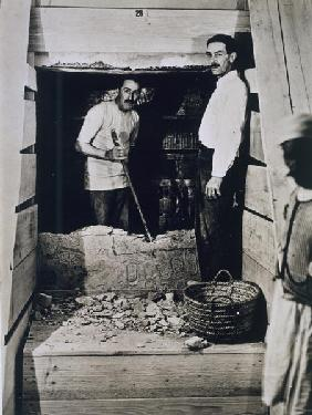 Howard Carter (1873-1939) and a colleague standing beside a partially demolished wall to one of the