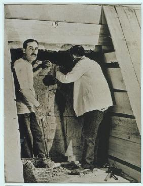 Howard Carter (1873-1939) and a colleague beside a partially demolished wall of one of the tombs, Va