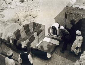 Moving the centre portion of one of the beds or couches from the Tomb of Tutankhamun, Valley of the