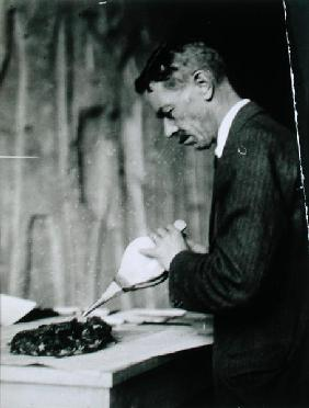 Mr Mace, Associate Curator of the Metropolitan Museum of Art, New York, treating one of the objects