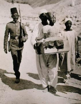 The mannequin or bust of Tutankhamun being carried from the tomb, Valley of the Kings, 1922 (gelatin