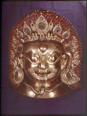 Head of Bhairava, embossed copper, painted and gilded, probably Nepalese late 17th
