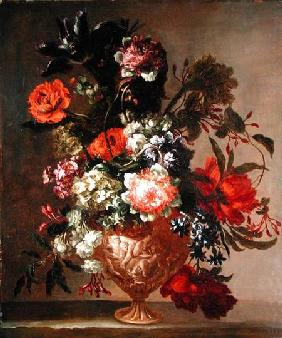 Still life of flowers in a sculpted vase