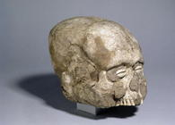 Portrait skull with cowrie shell eyes, Jericho, c.7th millennium BC (skull, plaster and shell) (side 1511