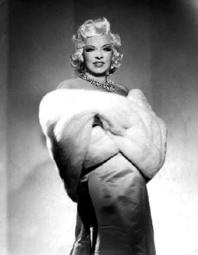 American Actress Mae West with fur stole c. 1940