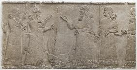 Carved relief of Tiglath-Pileser III receiving homage from a vanquished warrior, south-west palace,  745-727 BC