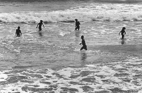Children playing in sea, Somnath (b/w photo)