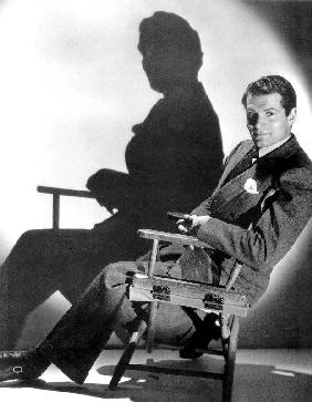 English Actor Laurence Olivier seated on a chair's director c. 1939