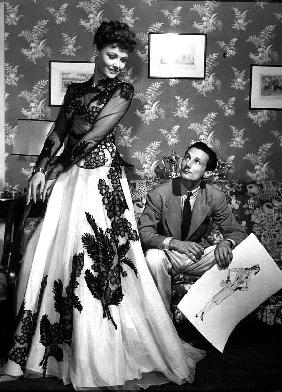 fashion designer Oleg Cassini showing his drawings to Gene Tierney to show her the clothes for film  in 1941