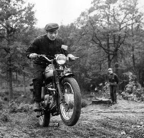 French Singer Ricet Barrier on a moto April 1965