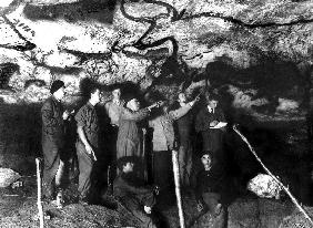 historical visit of the Cave of Lascaux, Montignac, France at the time of its discovery in 1940 l-r