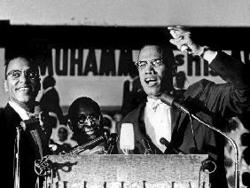 Malcolm X during a speech during a rally of Nation of Islam at Uline Arena, Washington, photo by Ric August 196