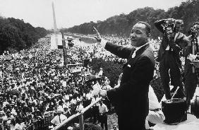 Martin Luther King American priest activist for Civil Right Movement of black Americans saluting the August 28,