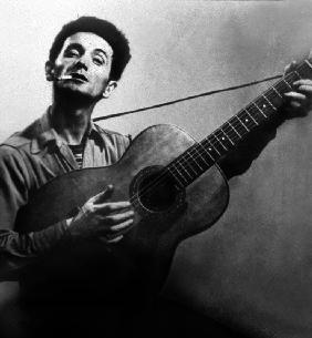 Musician Woody Guthrie considered as the father of folk music c. 1940