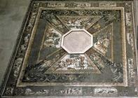 Mosaic pavement based round an octagonal basin, depicting the seasons and hunting scenes, from the C 1565