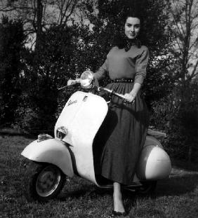 Paola Mori on a Vespa during her honeymoon with OrsonWelles in south of France May 1955