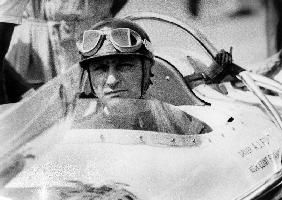 racing driver Fangio here at the wheel during race in Monza June 28, 1