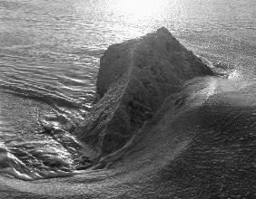 Rock in sea water (b/w photo)