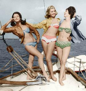 Three young women wearing bikinis colourized document late 50's