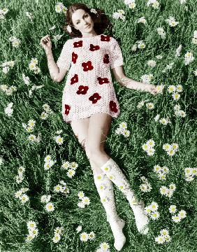 Young model Biddy Lampard in the grass wearing a short dress inspired by Courreges colourized docume August 196
