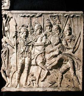 Relief from a sarcophagus depicting the submission of a barbarian to a Roman troop
