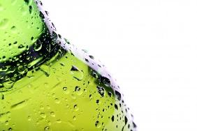 beer bottle with water droplets isolated