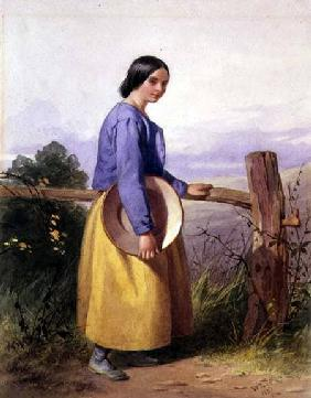 A country girl standing by a fence